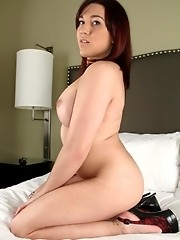 Irresistible tgirl Valerie stripping on the bed