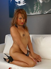 Transsexual cutie Lana strips and poses