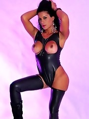 Big titted tranny playing with her juicy cock